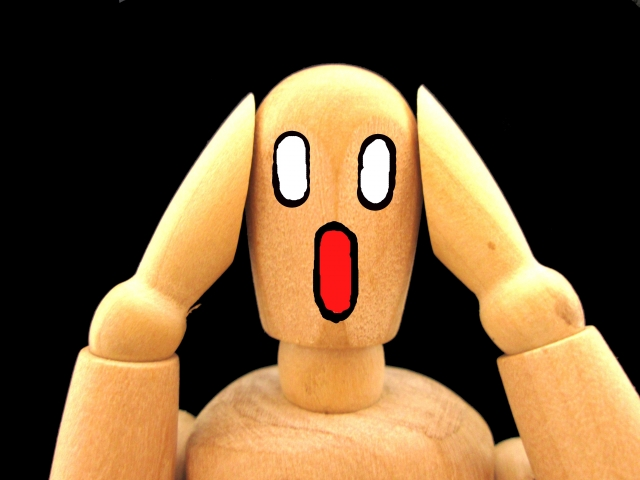 歯茎にできた内歯瘻(フィステル)に恐れる人形